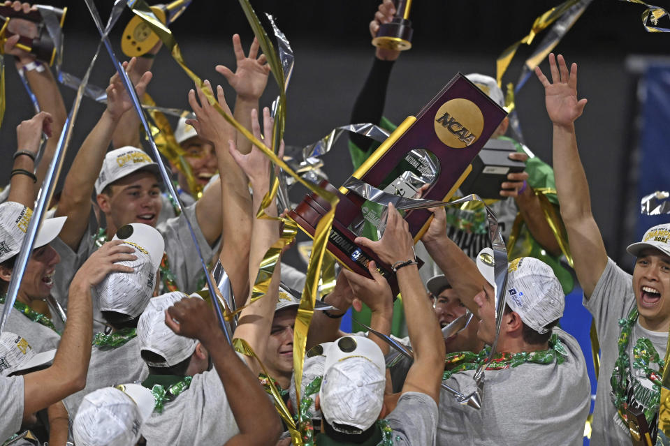 Hawaii team members hold the trophy after Hawaii defeated BYU in the final of the NCAA men's volleyball tournament Saturday, May 8, 2021, in Columbus, Ohio. (AP Photo/David Dermer)