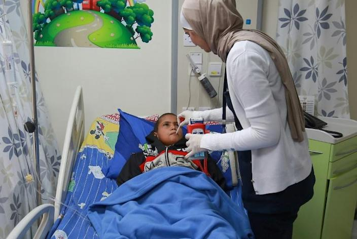 Yemeni Aymen, who is suffering from a congenital spinal malformation, receives treatment at the Amman hospital (AFP Photo/Khalil MAZRAAWI)