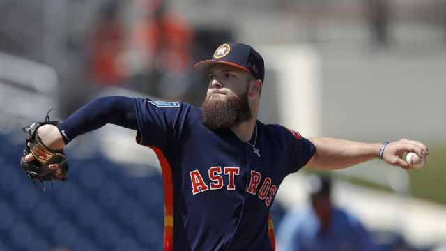 "<a class=""link rapid-noclick-resp"" href=""/mlb/players/9217/"" data-ylk=""slk:Dallas Keuchel"">Dallas Keuchel</a> says the 2018 Astros aren't like the 2017 Cubs, but it's up to the Astros to prove it. (AP Photo)"