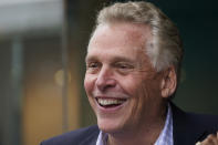Democratic gubernatorial candidate, former Gov. Terry McAuliffe, greets supporters during a tour of downtown Petersburg, Va., Saturday, May 29, 2021. McAuliffe faces four other Democrats in the a primary June 8. (AP Photo/Steve Helber)