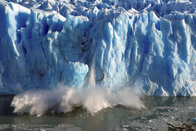 FILE PHOTO: Splinters of ice peel off from one of the sides of the Perito Moreno glacier