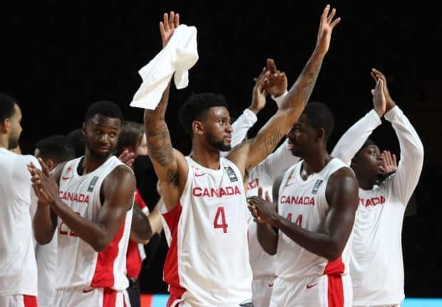 Canada's Nickeil Alexander-Walker (4) celebrates with teammates following their 109-79 win over China at the last-chance Olympic basketball qualifier on Wednesday in Victoria. (Chad Hipolito/The Canadian Press - image credit)