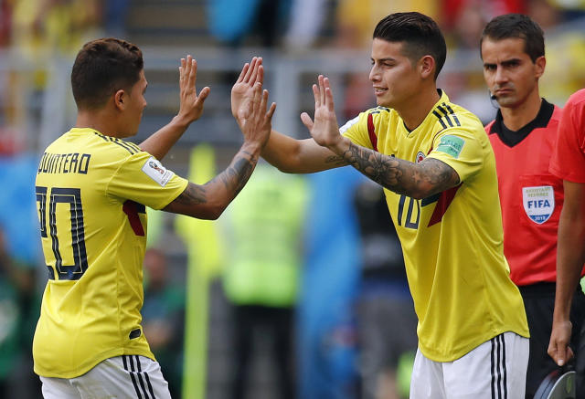 Colombia's James Rodriguez, right, replaces Juan Quintero during the group H match between Colombia and Japan at the 2018 soccer World Cup in the Mordavia Arena in Saransk, Russia, Tuesday, June 19, 2018. (AP Photo/Natacha Pisarenko)