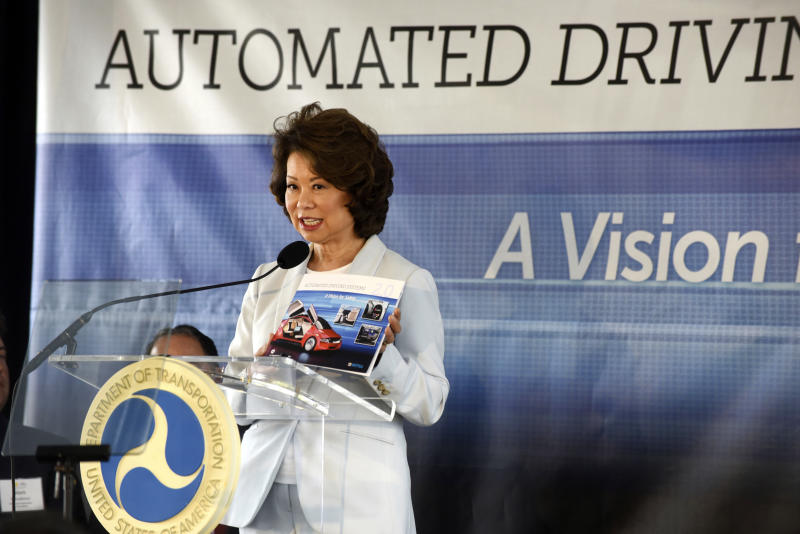 U.S. Transportation Secretary Elaine Chao announces new voluntary safety guidelines for self-driving cars during a visit to an autonomous vehicle testing facility, Tuesday, Sept. 12, 2017, at the University of Michigan, in Ann Arbor, Mich. The new guidelines update policies issued last fall by the Obama administration, which were also largely voluntary. (Max Ortiz/Detroit News via AP)