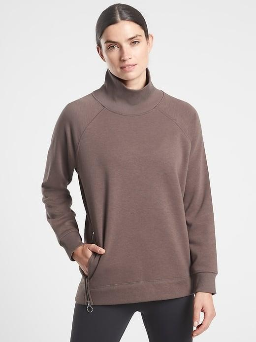 <p>The inside of this <span>Athleta Cozy Karma Side Zip Funnel Neck</span> ($108) is the supersoft plush of your dreams.</p>