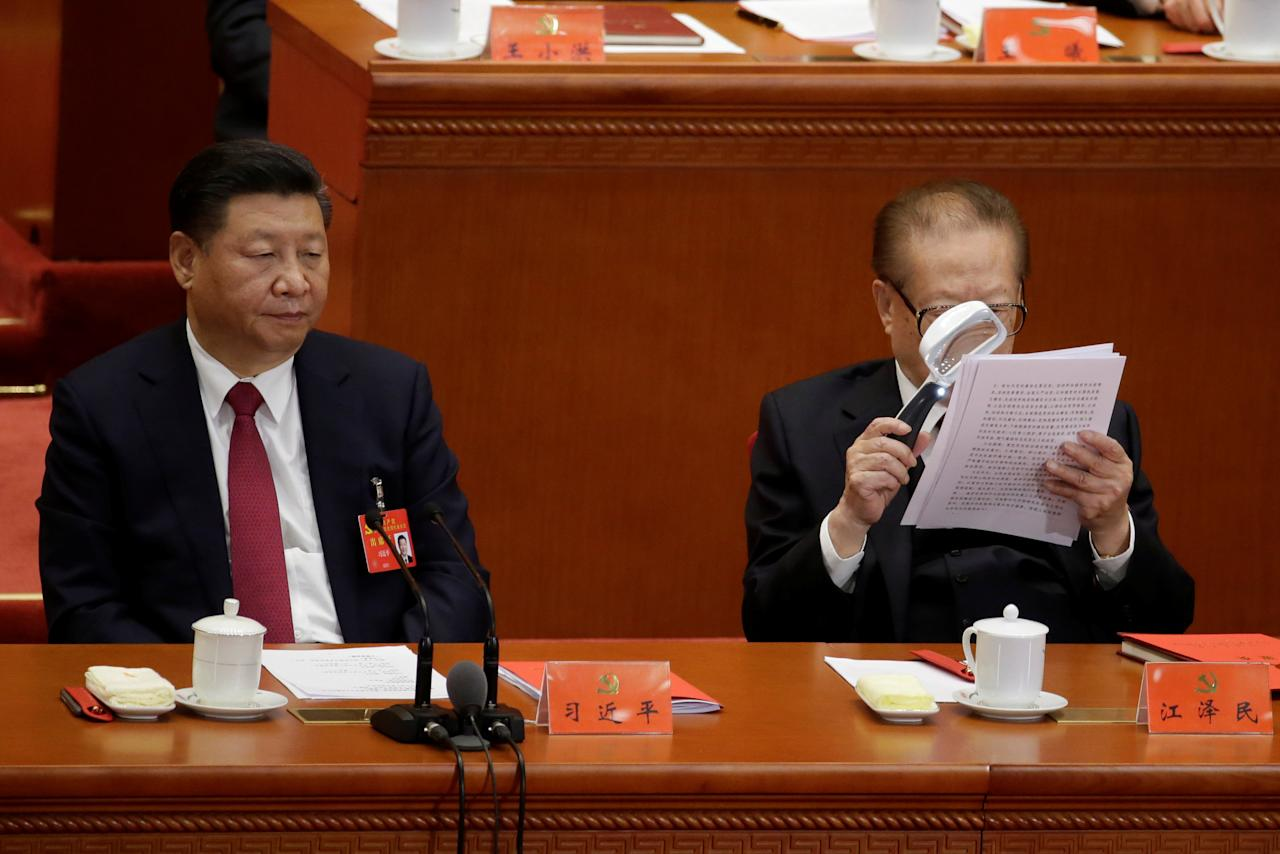 Chinese President Xi Jinping (L) and former Chinese President Jiang Zemin are seen during the closing session of the 19th National Congress of the Communist Party of China at the Great Hall of the People, in Beijing, China October 24, 2017. REUTERS/Jason Lee