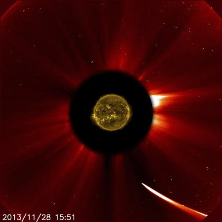 Comet ISON moves quite close to the sun in this image from ESA/NASA's Solar and Heliospheric Observatory captured at 10:51 a.m. EST on November 28, 2013, courtesy of NASA. REUTERS/ESA&NASA/SOHO/SDO/Handout via Reuters