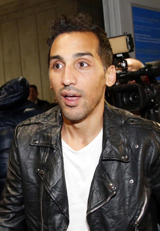 French Algerian football player Zahir Belounis arrives from Qatar at Roissy Charles De Gaulle airport, north of Paris, France, Thursday, Nov. 28, 2013. Belounis said he was stranded in Qatar with his wife and their two daughters. He was refused the exit visa he needed to leave because of a legal dispute over unpaid wages with Qatari side Al-Jaish, where he was under contract until 2015. (AP Photo/Francois Mori)