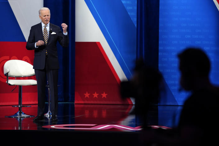 President Joe Biden talks during a televised town hall event at Pabst Theater, Tuesday, Feb. 16, 2021, in Milwaukee. (AP Photo/Evan Vucci)