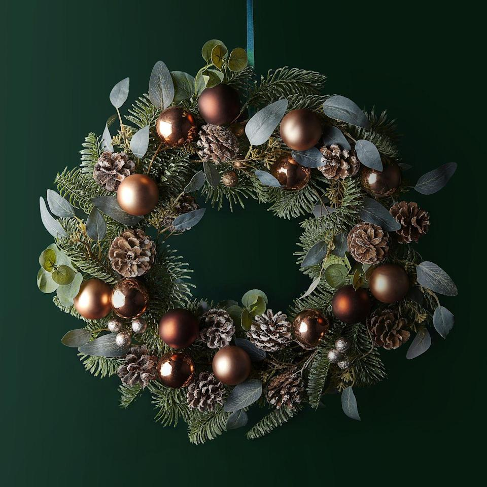 <p>A Christmas wreath isn't just for the front door. You could place it in your hallway or use it as a table centrepiece. </p><p>'Copper will continue to be a big colour trend this Christmas thanks to its warming qualities and autumnal vibe,' say Waitrose.</p>
