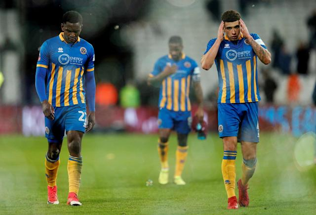 Soccer Football - FA Cup Third Round Replay - West Ham United vs Shrewsbury Town - London Stadium, London, Britain - January 16, 2018 Shrewsbury Town's Aristote Nsiala and Ben Godfrey look dejected after the match Action Images via Reuters/John Sibley