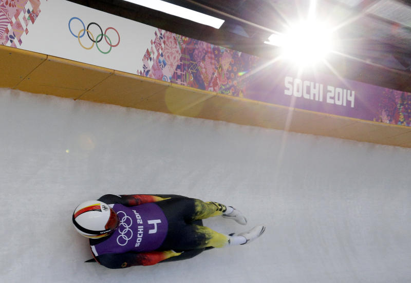 Felix Loch from Germany takes a turn during a training session for the men's singles luge at the 2014 Winter Olympics, Friday, Feb. 7, 2014, in Krasnaya Polyana, Russia. (AP Photo/Michael Sohn)