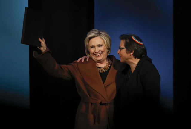 Former Secretary of State Hillary Clinton, left, waves to the crowd after speaking during a benefit to celebrate the 25th anniversary of Rabbi Sharon Kleinbaum, right, and Congregation Beit Simchat Torah, Monday, Dec. 4, 2017, in New York. (Photo: AP/Julie Jacobson)