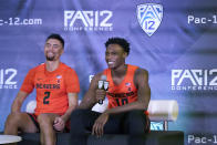 Oregon State's Warith Alatishe, right, speaks next to Jarod Lucas during the Pac-12 Conference NCAA college basketball media day Wednesday, Oct. 13, 2021, in San Francisco. (AP Photo/Jeff Chiu)
