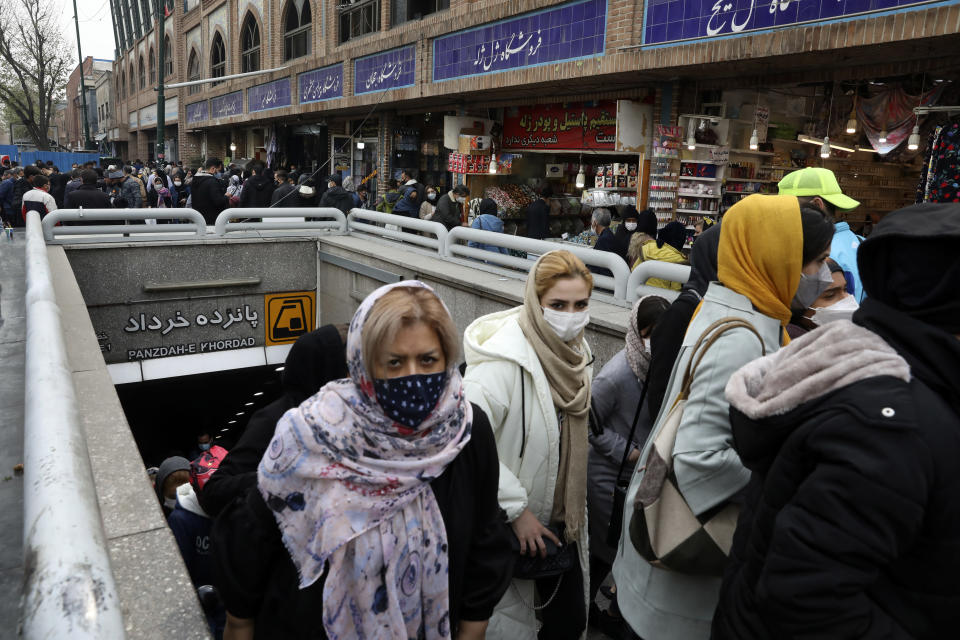 """Mask-clad commuters leave a metro station at Tehran's Grand Bazaar, ahead of the Persian New Year, or Nowruz, meaning """"New Day"""" in Iran, Monday, March 15, 2021. (AP Photo/Vahid Salemi)"""