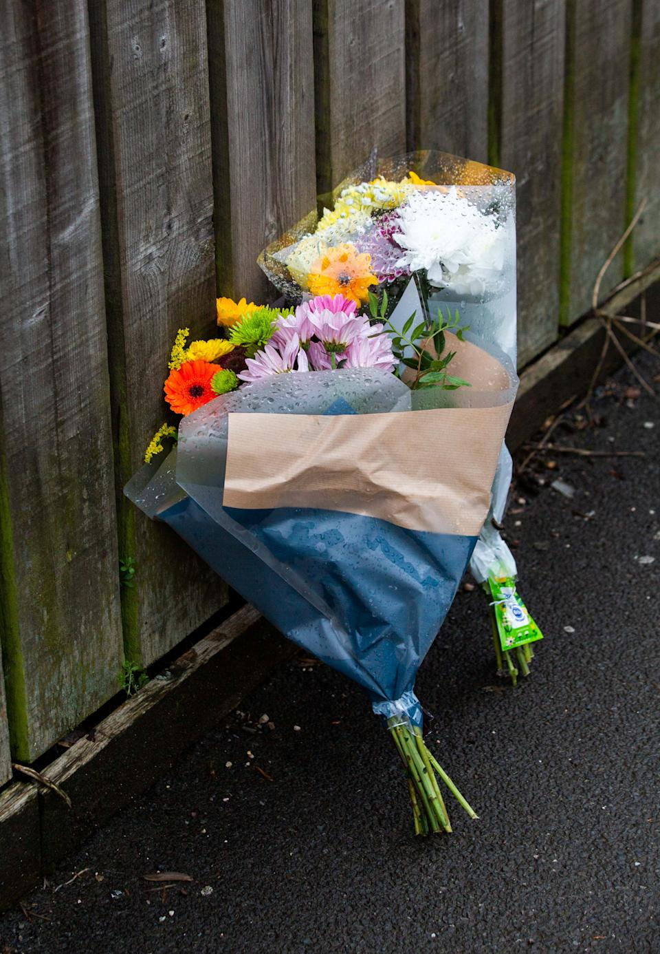 Floral tributes have been left by Clayton Road, Exeter after a fire claimed the lives of three people. 22nd February 2021.  A four-year-old girl and a couple have died in a house fire, police have said.  See SWNS story SWBRfire.  The girl, a man, 29, and a woman, 28, died following the fire in Clayton Road, Exeter.  Three other children who were in the house, two boys aged four and nine and a seven-year-old girl, are in a stable condition in hospital said officers.  Police called it a
