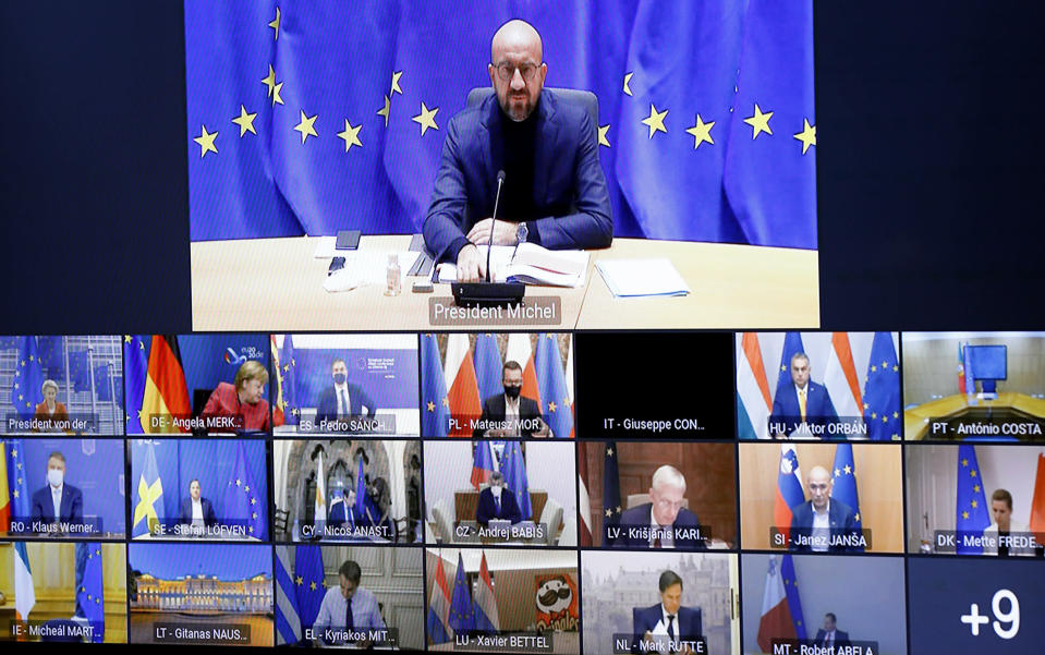 FILE - In this Thursday, Oct. 29, 2020 file photo, European Council President Charles Michel speaks with EU leaders during an EU Summit video conference at the European Council building in Brussels, to address the need to strengthen the collective effort to fight the COVID-19 pandemic. A last-minute trade deal with the United Kingdom coupled with the rollout of COVID-19 vaccines in the final days of the year produced a sense of success for the 27-nation bloc and brought glimmers of hope to the EU's 450 million residents. (Olivier Hoslet/Pool via AP, File)