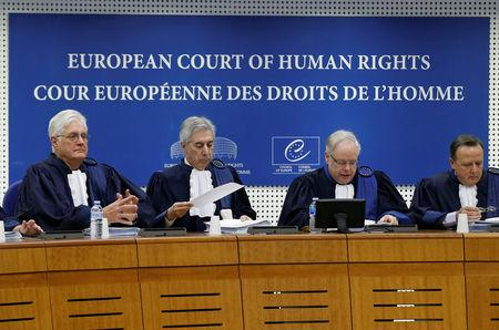 FILE PHOTO: Judges of the European Court of Human Rights sit in the courtroom at the start of an hearing concerning the case of Vincent Lambert in Strasbourg, January 7, 2015. REUTERS/Vincent Kessler/File Photo