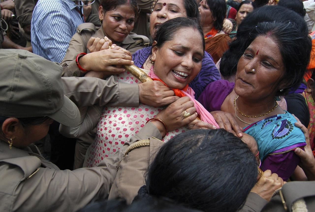 Supporters of Bharatiya Janata Party (BJP) are stopped by police from moving towards the office of Akhilesh Yadav, the chief minister of the northern Indian state of Uttar Pradesh, during a protest against recent rape and hanging of two girls, in Lucknow June 2, 2014. Three men were arrested for the crime in Uttar Pradesh that underscored the enduring culture of sexual assault in India and the capacity for appalling violence between Hindu castes. Two policemen were held on suspicion of attempting to cover up the killings. On Monday, Modi's BJP sought to make political capital. Workers from the party accused the Uttar Pradesh state government, headed by Samajwadi Party, of negligence over the crimes and of being unfit to govern. Police fired water cannon at the protesters, who were demanding the state government be dismissed and the imposition of direct, presidential rule. REUTERS/Pawan Kumar (INDIA - Tags: POLITICS CRIME LAW)