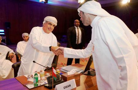 Oman Oil Minister Mohammed bin Hamad Al Rumhy shakes hand with a representive of Kuwait Oil Company during OPEC 2nd Joint Ministerial Monitoring Committee meeting in Kuwait City