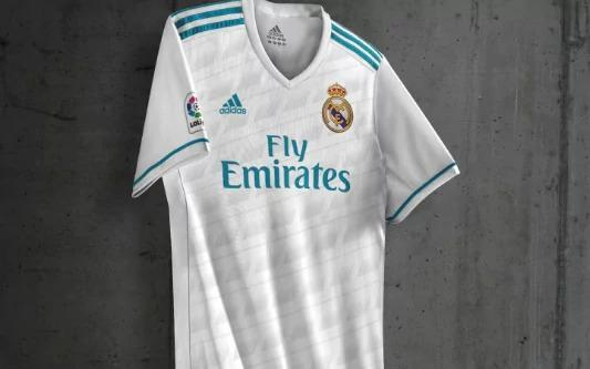 <p>Blue strips for Real Madrid? Really? </p>