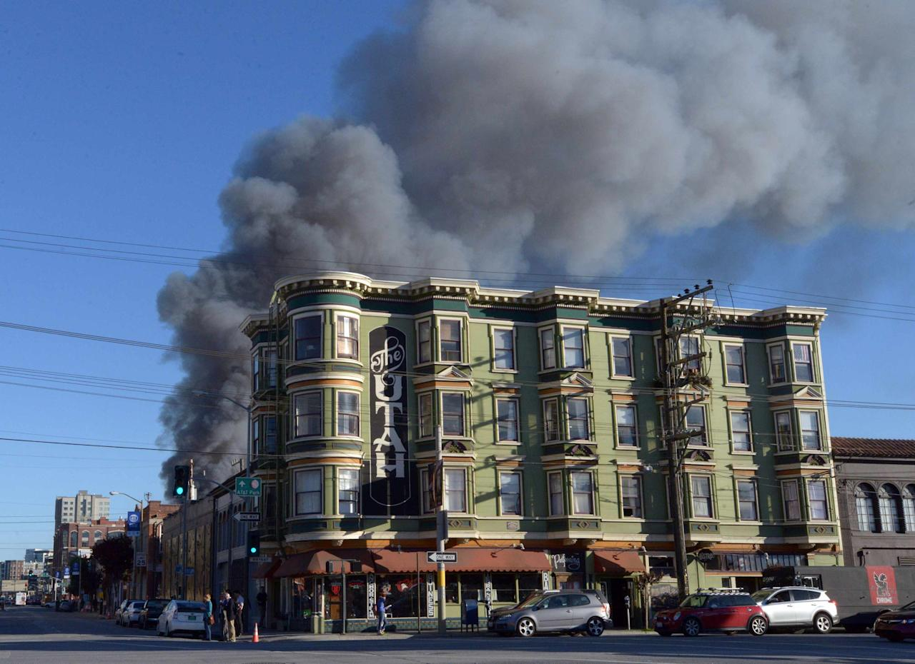 Smoke billows from a fire at a construction site in the China Basin area of San Francisco March 11 2014.   REUTERS/Josh Edelson  (UNITED STATES - Tags: DISASTER ENVIRONMENT)