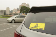 A vehicle with a Gadsden flag sticker is parked in the lot at Independence Point, Friday, Sept. 10, 2021, in Coeur d'Alene, Idaho. Northern Idaho has a long and deep streak of antigovernment activism that is confounding attempts to battle a COVID-19 outbreak.(AP Photo/Young Kwak)