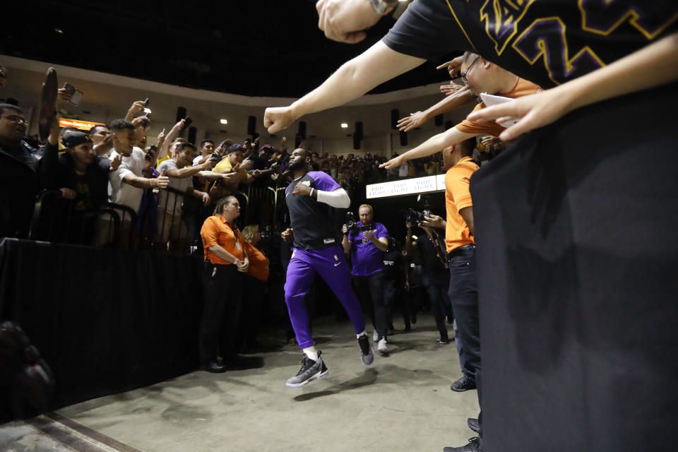 Los Angeles Lakers forward LeBron James ran on his way to the court before the NBA preseason basketball game against the Denver Nuggets in San Diego on Sunday, September 30, 2018.  (AP Photo/Gregory Bull)