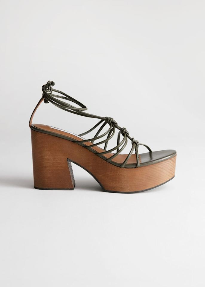 """$129, & Other Stories. <a rel=""""nofollow"""" href=""""https://www.stories.com/en_usd/shoes/all/product.lace-up-wooden-platforms-khaki.0748663001.html"""">Get it now!</a>"""