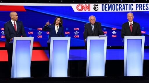 Senator Kamala Harris (2L) struggled to define her positions on domestic issues including health care