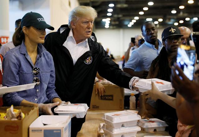 <p>President Donald Trump and first lady Melania Trump help volunteers hand out meals during a visit with flood survivors of Hurricane Harvey at a relief center in Houston, Texas, Sept. 2, 2017. (Photo: Kevin Lamarque/Reuters) </p>