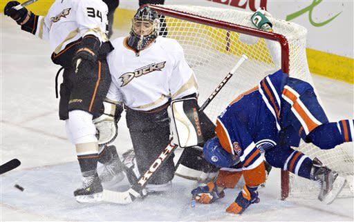 Anaheim Ducks goalie Jonas Hiller makes the save as Edmonton Oilers' Sam Gagner crashes the net during the second period of their NHL hockey game in Edmonton, Alberta, Sunday, April 21, 2013. (AP Photo/The Canadian Press, Jason Franson)