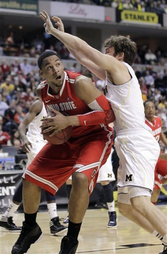 Ohio State forward Jared Sullinger, left, drives to the basket against Michigan forward Zack Novak in the first half of an NCAA college basketball game in the semifinals of the Big Ten Conference tournament in Indianapolis, Saturday, March 10, 2012. (AP Photo/Michael Conroy)