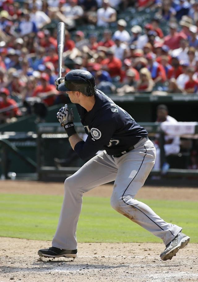 Seattle Mariners' Michael Saunders follows through on his run-scoring double to right off a pitch from Texas Rangers' Yu Darvish in the sixth inning of a baseball game on Sunday, Aug. 18, 2013, in Arlington, Texas. The hit scored Nick Franklin. (AP Photo/Tony Gutierrez)