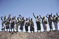 FILE - In this Sept. 22, 2014 file photo, Hawthi Shiite rebels chant slogans at the compound of the army's First Armored Division, after they took it over, in Sanaa, Yemen. Yemen's war began in September 2014, when the Houthis seized the capital Sanaa. Saudi Arabia, along with the United Arab Emirates and other countries, entered the war alongside Yemen's internationally recognized government in March 2015. The war has killed some 130,000 people and driven the Arab world's poorest country to the brink of famine. (AP Photo/Hani Mohammed, File)