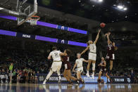 Texas A&M's Chennedy Carter (3) shoots over Notre Dame's Brianna Turner (11) during the first half of a regional semifinal game in the NCAA women's college basketball tournament, Saturday, March 30, 2019, in Chicago. (AP Photo/Nam Y. Huh)