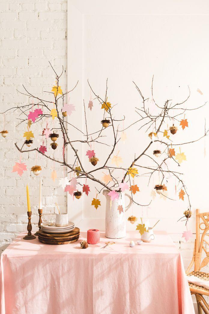 """<p>Your guests will be grateful for the acorn favors that hang from this arrangement. Each one contains lip balm for when that cold November weather hits.</p><p><strong>Get the tutorial at <a href=""""http://thehousethatlarsbuilt.com/2018/10/gratitude-tree-acorn-favors.html/#more-35256"""" rel=""""nofollow noopener"""" target=""""_blank"""" data-ylk=""""slk:The House That Lars Built"""" class=""""link rapid-noclick-resp"""">The House That Lars Built</a>.</strong></p><p><strong><a class=""""link rapid-noclick-resp"""" href=""""https://www.amazon.com/eos-Visibly-Soft-Balm-Sphere/dp/B01KA6ZDVO/?tag=syn-yahoo-20&ascsubtag=%5Bartid%7C10050.g.1371%5Bsrc%7Cyahoo-us"""" rel=""""nofollow noopener"""" target=""""_blank"""" data-ylk=""""slk:SHOP LIP BALMS"""">SHOP LIP BALMS</a><br></strong></p>"""