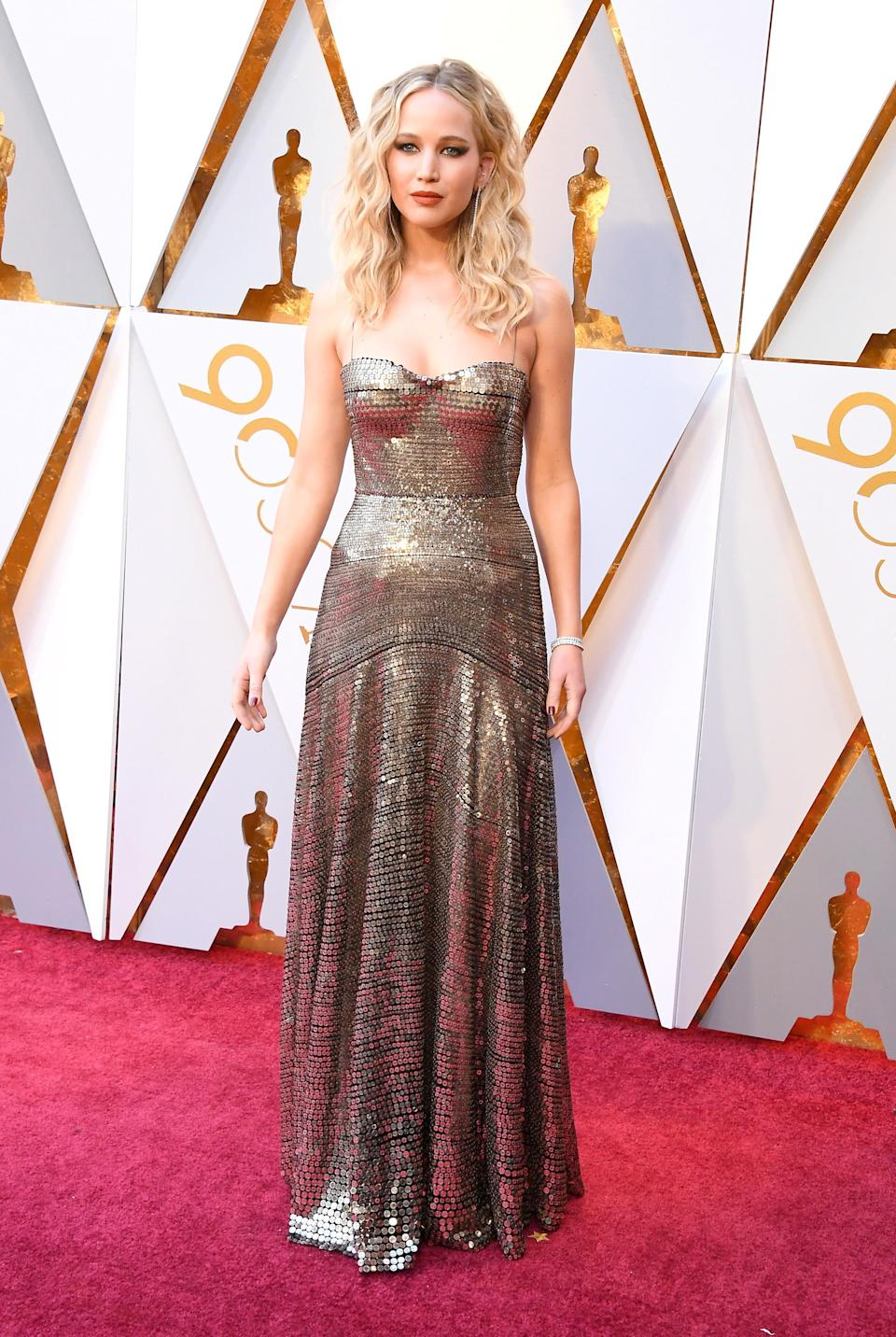 <p>The actress looked like she took the Oscars statue as her inspo with this gold gown she wore to the Academy Awards (Getty Images) </p>