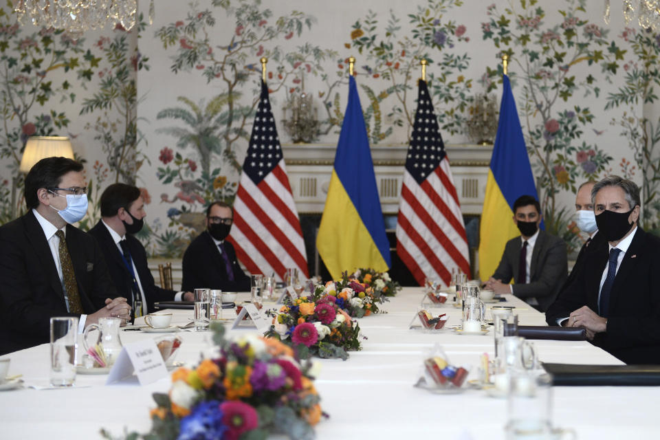 Ukrainian Foreign Minister Dmytro Kuleba, left, meets with United States Secretary of State Antony Blinken, right, in Brussels, Tuesday, April 13, 2021. (Johanna Geron, Pool via AP)