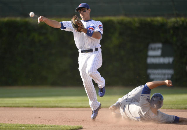 Chicago Cubs second baseman Darwin Barney, left, throws to first base after forcing out Los Angeles Dodgers' Andre Ethier on a ground ball hit by Jerry Hairston Jr. during the seventh inning of a baseball game, Saturday, Aug. 3, 2013 in Chicago. Hairston was safe at first. (AP Photo/Brian Kersey)