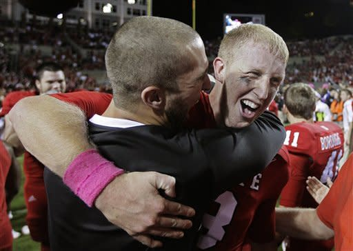 North Carolina State quarterback Mike Glennon, right, is congratulated following North Carolina State's 17-16 win over Florida State in an NCAA college football game in Raleigh, N.C., Saturday, Oct. 6, 2012. (AP Photo/Gerry Broome)