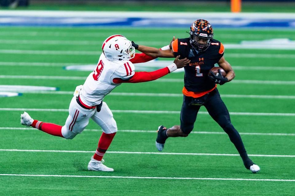 JoJo Earle (1) stiff arms Sir Hill (9) after catching a pass during the 2nd quarter of the 5A Division 2 state championship game at AT&T Stadium in Arlington between Aledo and Crosby on January 15th, 2021.