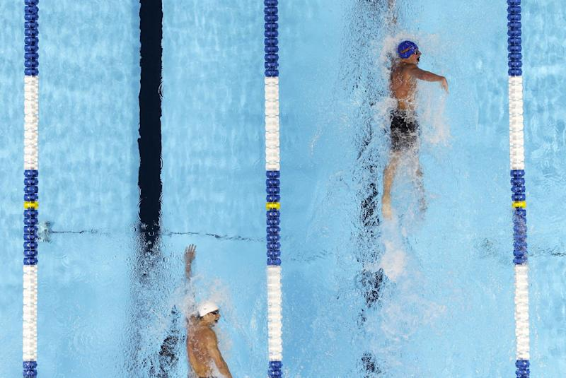 Ryan Lochte, right, leads Michael Phelps in the men's 400-meter individual medley final at the U.S. Olympic swimming trials, Monday, June 25, 2012, in Omaha, Neb. Lochte won the race. (AP Photo/Mark Humphrey)