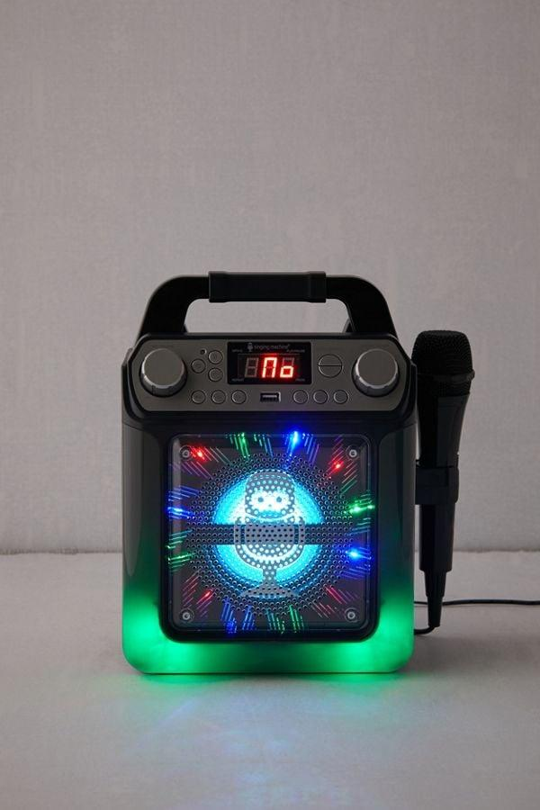 "<p>This cute <a href=""https://www.popsugar.com/buy/Singing-Machine-Groove-Cube-Mini-Karaoke-Machine-526477?p_name=Singing%20Machine%20Groove%20Cube%20Mini%20Karaoke%20Machine&retailer=urbanoutfitters.com&pid=526477&price=50&evar1=savvy%3Aus&evar9=45252636&evar98=https%3A%2F%2Fwww.popsugar.com%2Fphoto-gallery%2F45252636%2Fimage%2F46972867%2FSinging-Machine-Groove-Cube-Mini-Karaoke-Machine&list1=shopping%2Cgifts%2Choliday%2Cgift%20guide%2Cgifts%20for%20women%2Cgifts%20for%20men&prop13=api&pdata=1"" rel=""nofollow"" data-shoppable-link=""1"" target=""_blank"" class=""ga-track"" data-ga-category=""Related"" data-ga-label=""https://www.urbanoutfitters.com/shop/singing-machine-groove-cube-mini-karaoke-machine?category=lifestyle&amp;color=001"" data-ga-action=""In-Line Links"">Singing Machine Groove Cube Mini Karaoke Machine</a> ($50) is one the whole family will love.</p>"