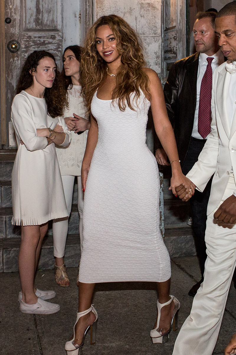 <p>Beyoncé wore a fitted ivory midi dress with matching platform heels for sister Solange's wedding in New Orleans.</p>