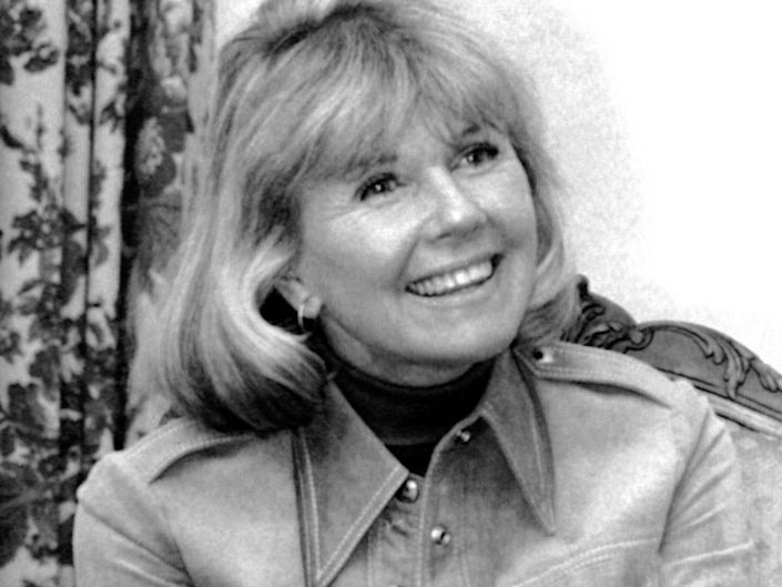 """FILE - In this Jan. 6, 1976 file photo, actress and singer Doris Day answers questions in New York, during an interview on the book """"Doris Day: Her Own Story,"""" written by A.E. Hotchner. Day, whose wholesome screen presence stood for a time of innocence in '60s films, has died, her foundation says. She was 97. The Doris Day Animal Foundation confirmed Day died early Monday, May 13, 2019, at her Carmel Valley, California, home.(AP Photo, File)"""