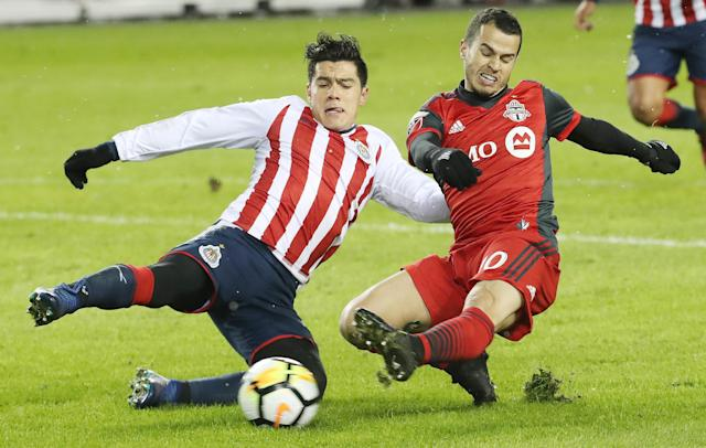 Toronto FC's Sebastian Giovinco and Chivas de Guadalajara's Michael Perez battle during the first leg of the CONCACAF Champions League final. (Getty)