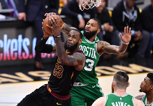 CLEVELAND, OH - MAY 21: LeBron James #23 of the Cleveland Cavaliers drives to the basket against Marcus Morris #13 of the Boston Celtics in the second half during Game Four of the 2018 NBA Eastern Conference Finals at Quicken Loans Arena on May 21, 2018 in Cleveland, Ohio. (Photo by Jamie Sabau/Getty Images)