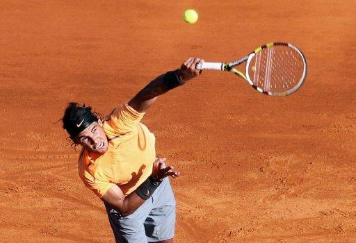 Spain's Rafael Nadal serves to France's Gilles Simon during their Monte Carlo ATP Masters Series match in Monaco. Nadal won 6-4, 6-4