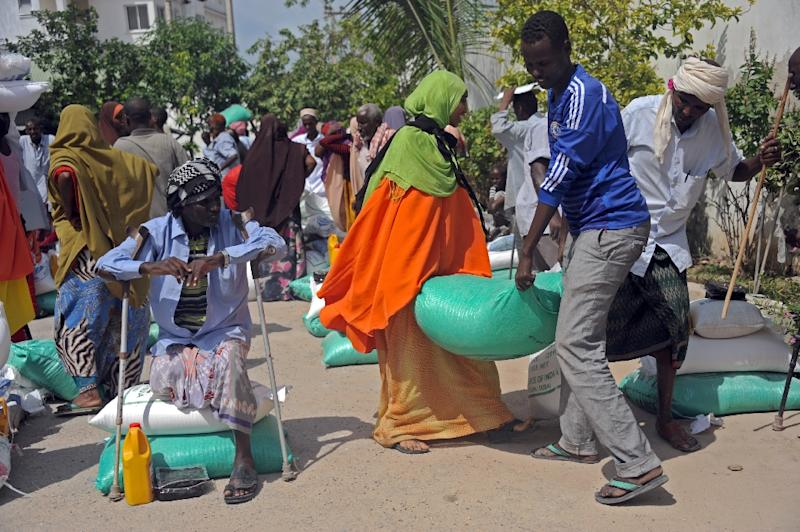 Somali internally displaced people (IDPs) receive food aid donated by a Qatari charity during the Muslim holy month of Ramadan in Mogadishu on June 20, 2015